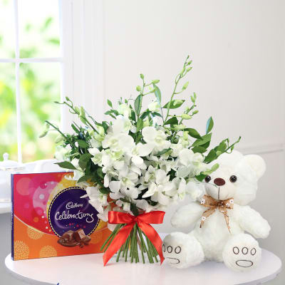 Bunch of 6 White Orchids with Teddy Bear & Cadbury Celebrations