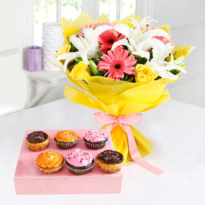 Bunch of Mix Flowers with Delicious Cupcakes