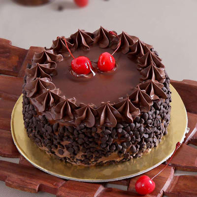 Chocolate Cake With Chips Cherry Toppings 1