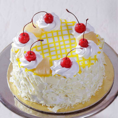 Classic Pineapple Cake (Eggless) with Cherry Toppings (Half Kg)