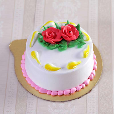 Classic Vanilla Cake With Rose Toppings Half Kg