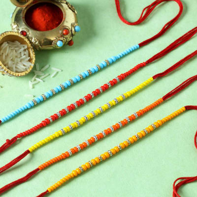 CZ Ring Rakhis with Multicolour Beads (Set of 5)