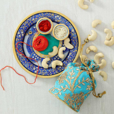 Dry Fruits Potli with Decorative Marble Puja Thali