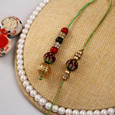 Send gifts to australia flowers cakes delivery in australia elegant bhaiya bhabhi rakhi set negle Images