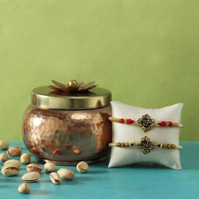 Ethnic Flower Design Metal Rakhi With Metal Pot Filled with Pistachio