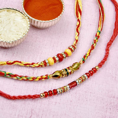Fancy Crystal and Colorful Beaded Rakhi Set of Three