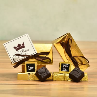 Flavored Chocolates in Golden Pouch with Ribbon