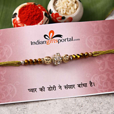 Send gifts to uk from india best gifts to london free gift golden bobs stone premium rakhi negle Images