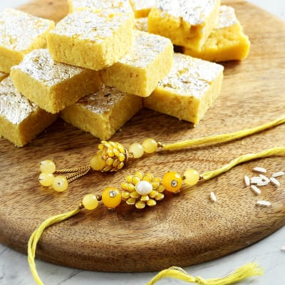 Kadi Kundan Work Yellow Pachhi Designed Bhaiya Bhabhi Rakhi With Moong Dal Barfi
