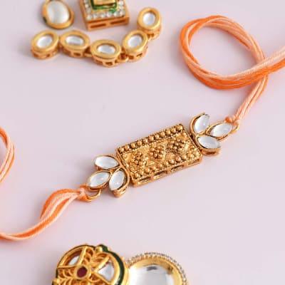 Kundan Rakhi with White & Golden Stones