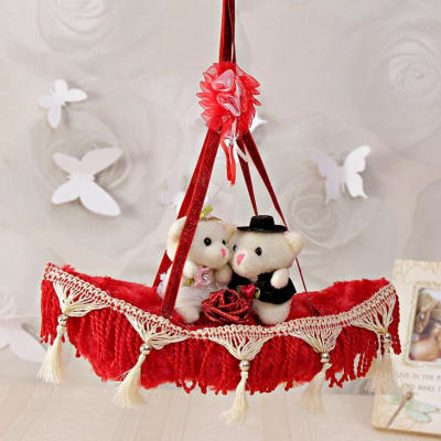 Love Couple In Red Colour Hanging Boat