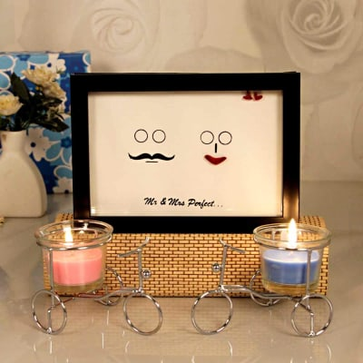 Lovely Frame With Pink Blue Candles Holder In A Gift