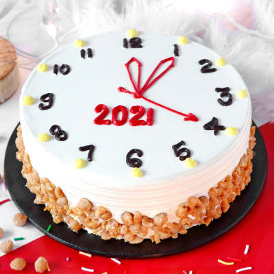 New Year Clock Butterscotch Cake (Eggless) (Half Kg)