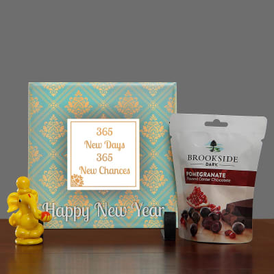 New Year Tile With Brookside Dark Chocolates And Cute Ganesha Idol