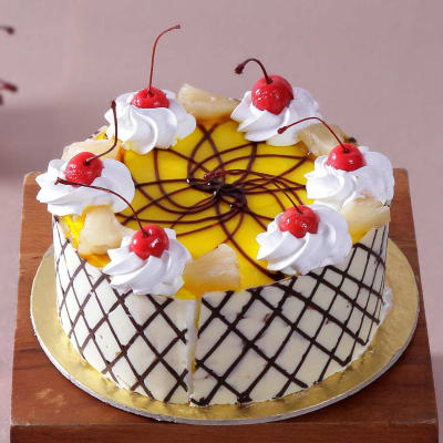 Pineapple Cake With Cherry Cream Toppings Half