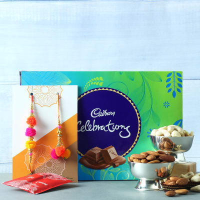 Pom Pom Bhaiya Bhabhi Rakhi with Cadbury Celebrations & Dry Fruits Hamper