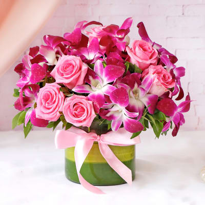 Purple Orchids & Pink Roses In Round Vase