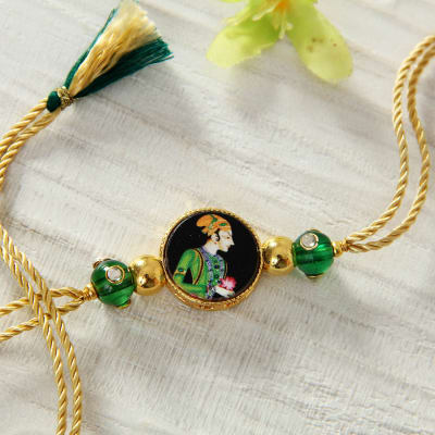 Send gifts to new zealand online flowers cakes delivery in new raja design stone rakhi with pearl dibbi negle Images