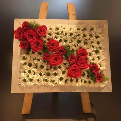 Seasonal flowers in square wooden container