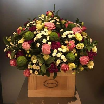 Seasonal flowers in wooden vase