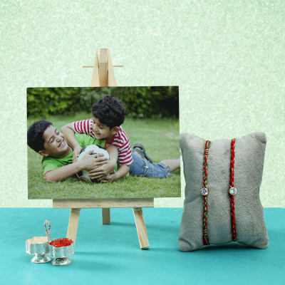 Set Of 2 CZ Stone Rakhis With Table Canvas & Roli-Chawal Container
