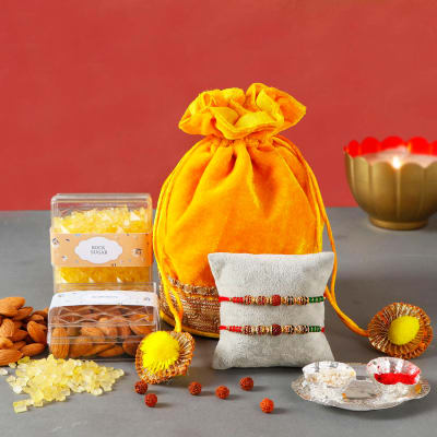 Set of 2 Rakhis with Almond & Mishri and Silver Plated Roli Chawal Plate in Potli