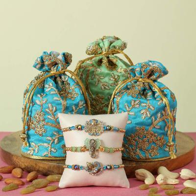Set of Three Ganesha and Peacock Rakhi with Jari work Potli Filled with Dry  Fruits