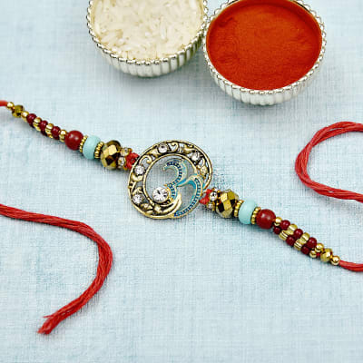 Silver Om Rakhi, decorated with CZ stones and Pearls