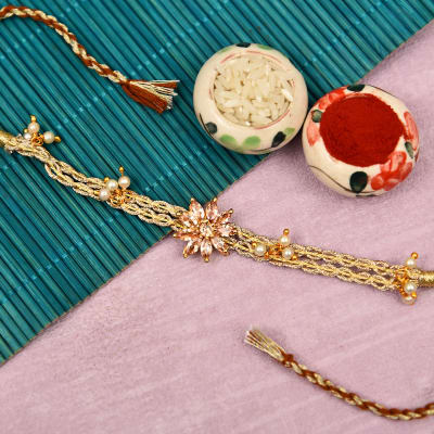 Solitaire Studded Flowery Rakhi with Pearls & Shiny Thread