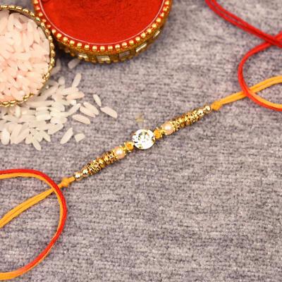 Stone Rakhi with Golden Beads