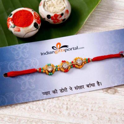 Stone Studded Thread Rakhi