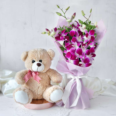 Sublime Orchids Bouquet with Teddy  (12 inch)