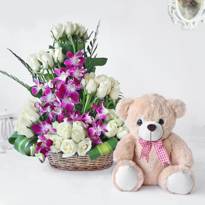 White Roses and Orchids in Cane Basket with Teddy Bear