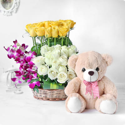 Yellow and White Roses with Orchids in Basket with Teddy Bear