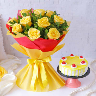 Yellow Roses Arrangement in Ribbon Bouquet with Pineapple Cake (Half Kg)