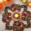 Beautiful Pearl Diya with Elephant Designed Rangoli