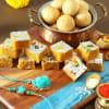 Bhaiya Bhabhi Rakhi with Moong Dal Barfi & Dry Fruit Kachori Hamper Online