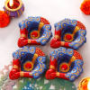Blue and Red Painted Clay Diya