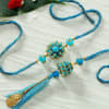 Gift Blue Pachhi Work Bhaiya Bhabhi Rakhis with Personalized Pink And Blue Handle Mug Set