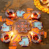 Decorated Blue & Red Painted Clay Diya with Traditional Camel Design Rangoli