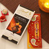 Designer Rakhi with Lindt caramel chocolate bar and roli chawal kit