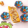 Set of 4 Flower Shaped Clay Diyas with 450 Gms Dryfruit Cassata Roll