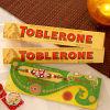 Stone Work Rakhi With Pack of Two Toblerone Chocolates