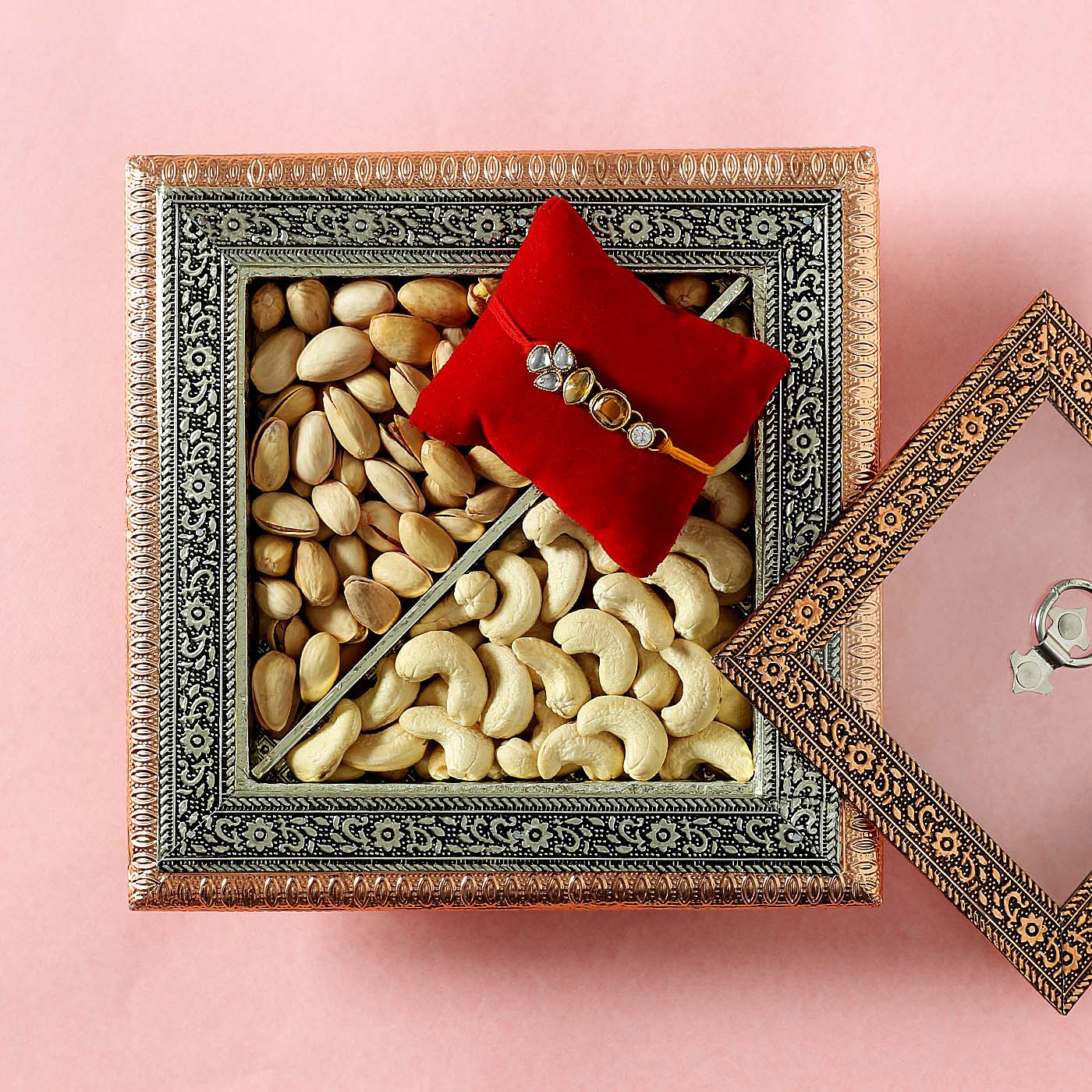 copper-kundan-rakhi-with-cashews-pistachio-in-wooden-metal-embossed-box