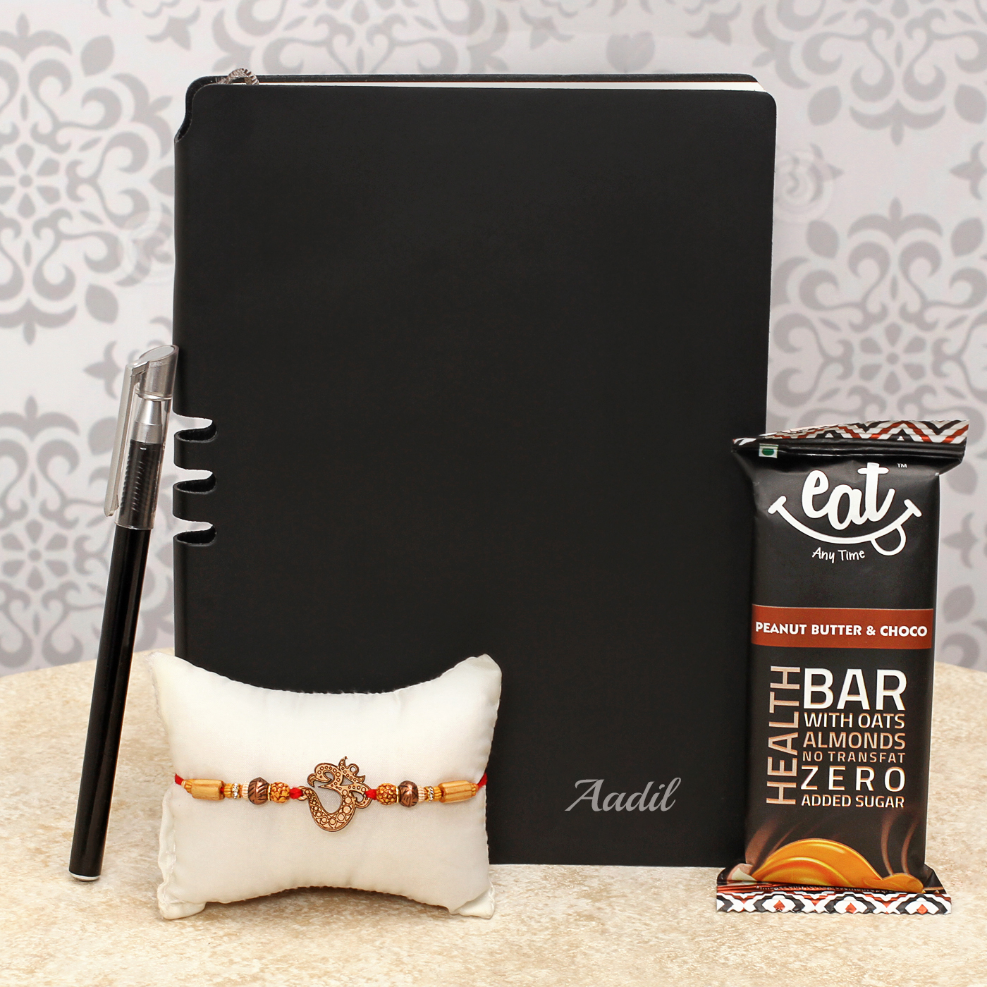 traditional-om-design-rakhi-with-black-personalized-diary-health-bar